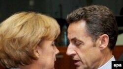 Бельгия- Франциянын президенти Николя Саркози жана Германиянын канцлери Ангела Меркель Евробиримдиктин Брюсселдеги саммитинде, 12-декабрь 2008