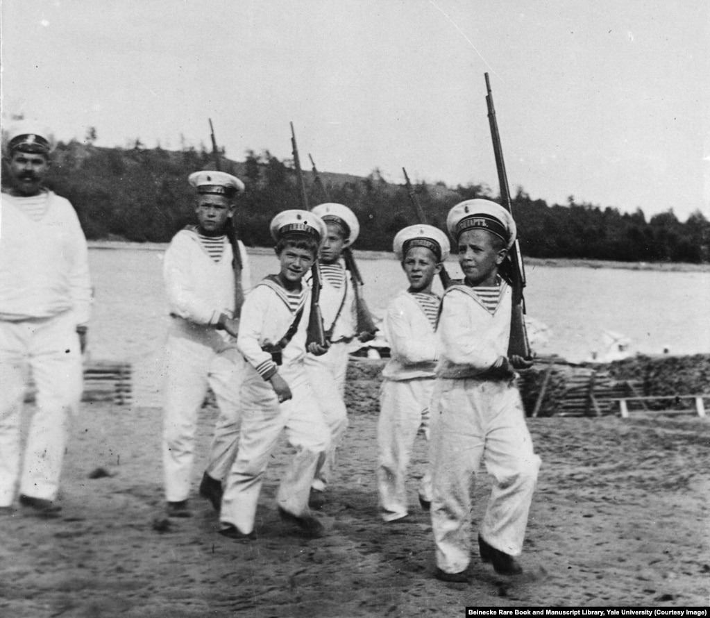 Tsarevich Aleksei, third from left, playing soldiers. Andrey Derevenko (far left) was one of two minders tasked with looking after the vulnerable heir apparent. Derevenko joined the Bolsheviks soon after the revolution and taunted the tsarevich before disappearing into obscurity.