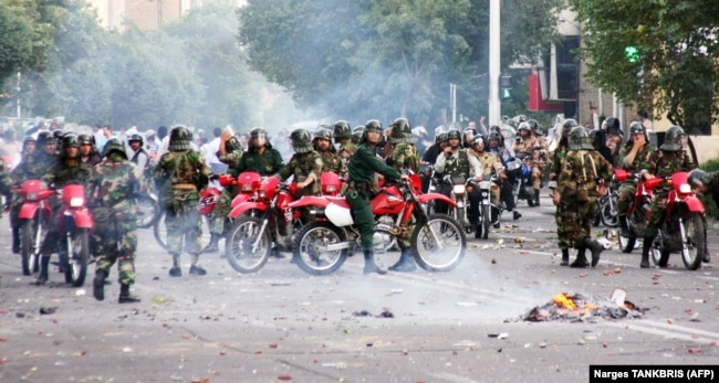 Iranian special units sit on motorcycles as they face protesters during a demonstration in Tehran on June 20, 2009.