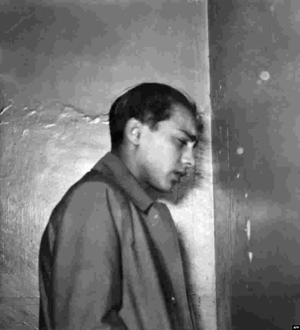 Herschel Grynszpan being taken to a Paris court on December 2, 1938. Grynszpan, a 16-year old Polish Jew who lived in Paris, shot and killed Ernst Vom Rath, a junior German diplomat on November 7, 1938, in the German Embassy in France. He staged the attack after hearing that his parents, brother, and sister were deported to Poland by Nazi authorities. Propaganda Minister Joseph Goebbels ordered that the news of the assassination be carried on the front pages of all German newspapers. The assassination was used as a pretext to launch the massive pogrom against the German Jewish communities.