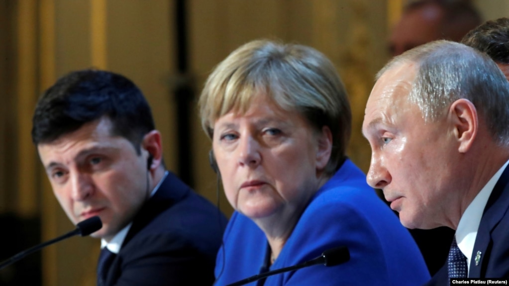 FRANCE -- Ukraine's President Volodymyr Zelenskiy, German Chancellor Angela Merkel and Russia's President Vladimir Putin attend a joint news conference after a Normandy-format summit in Paris, France December 10, 2019.