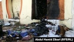 آثار التدمير على محل للخمور في أربيل