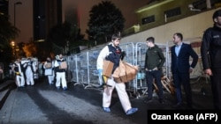Turkish forensic police officers leave after searching for evidence at the Saudi Consulate in Istanbul on October 18.