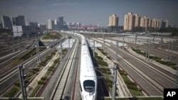 A high-speed train leaves Beijing's South Station for Shanghai