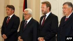 Palestinian President Mahmud Abbas (second from left) is welcomed by members of Bosnian Presidency, Zeljko Komsic (left), Bakir Izetbegovic (second from right), and Nebojsa Radmanovic (right) upon his arrival for bilateral talks in Sarajevo on August 15.