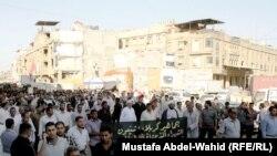 جانب من تشييع ضحايا حادثة النخيب في كربلاء