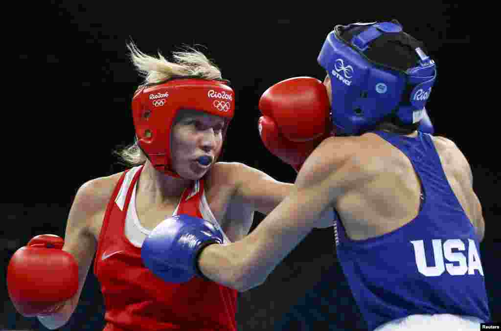 Anastasia Belyakova of Russia fights Mikaela Mayer of the United States in the women's 60-kilogram boxing quarterfinals.