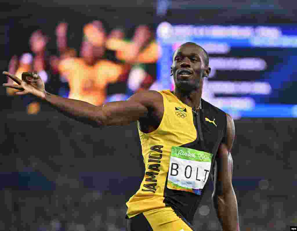 Usain Bolt of Jamaica celebrates winning the men's 4 x 100-meter relay final.