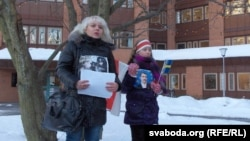 Volha Klaskouskaya (left)protests outside the Belarusian Embassy in Stockholm in January 2011.