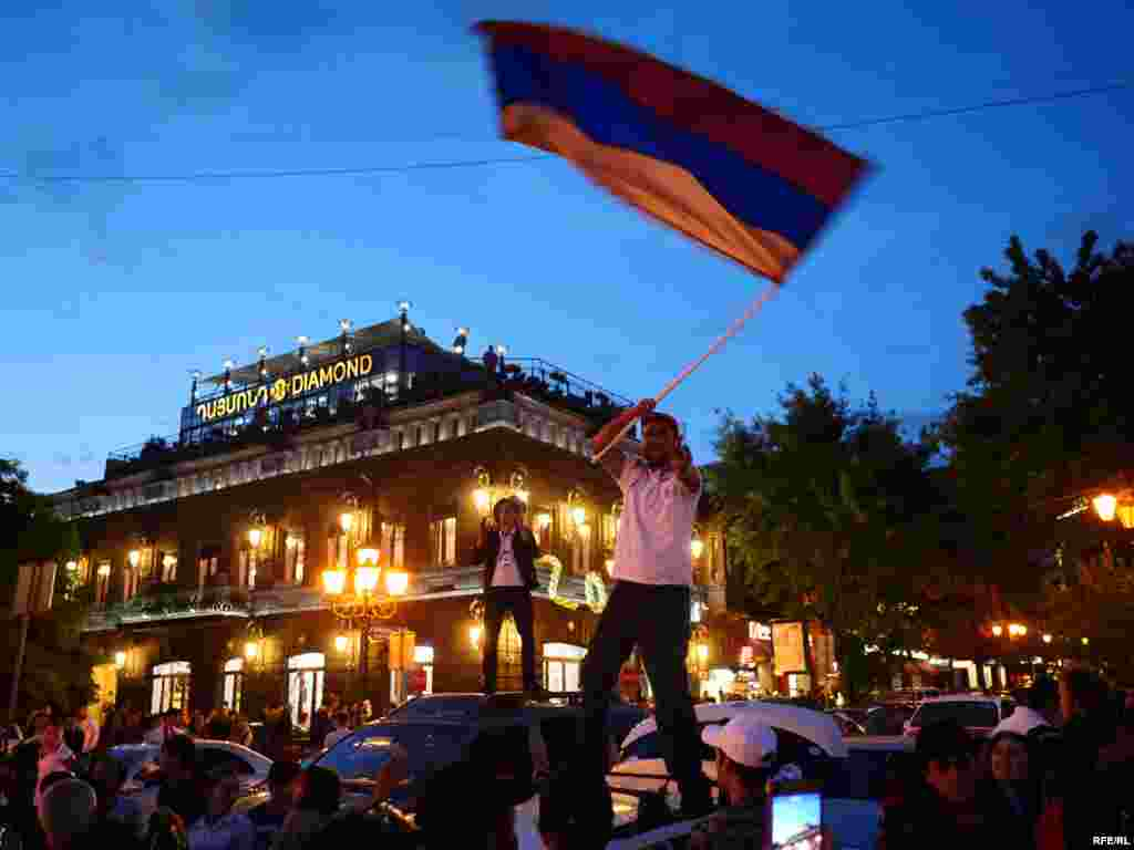 As dusk fell, spontaneous street celebrations broke out in the center of Yerevan.