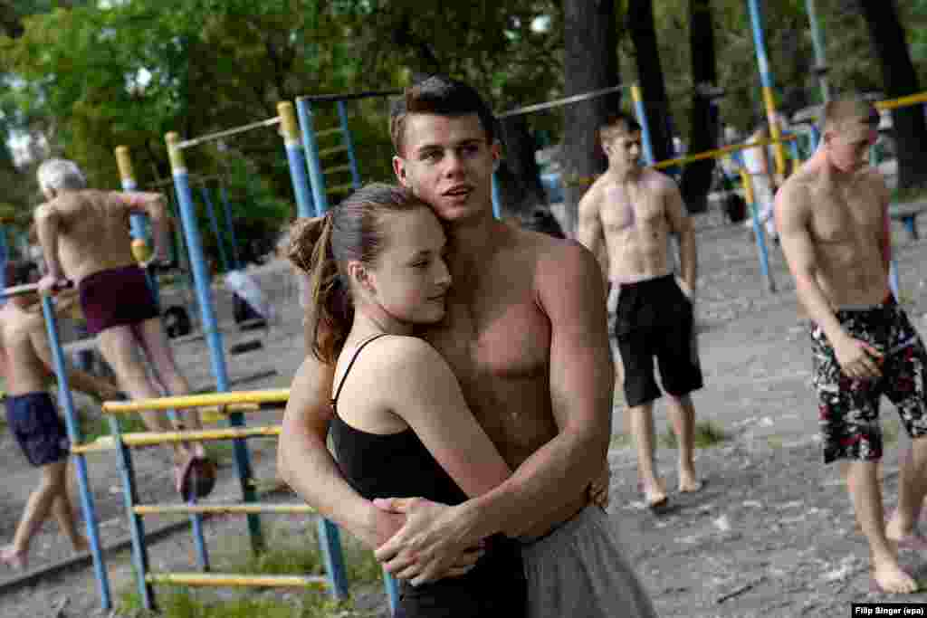 A young couple between workouts. As well as old and young, the legendary gym reportedly attracts rich and poor.