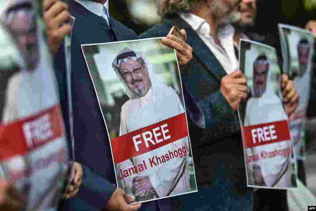 Protesters hold pictures of missing journalist Jamal Khashoggi during a demonstration in front of the Saudi Arabian Consulate in Istanbul on October 5. (AFP/Ozan Kose)
