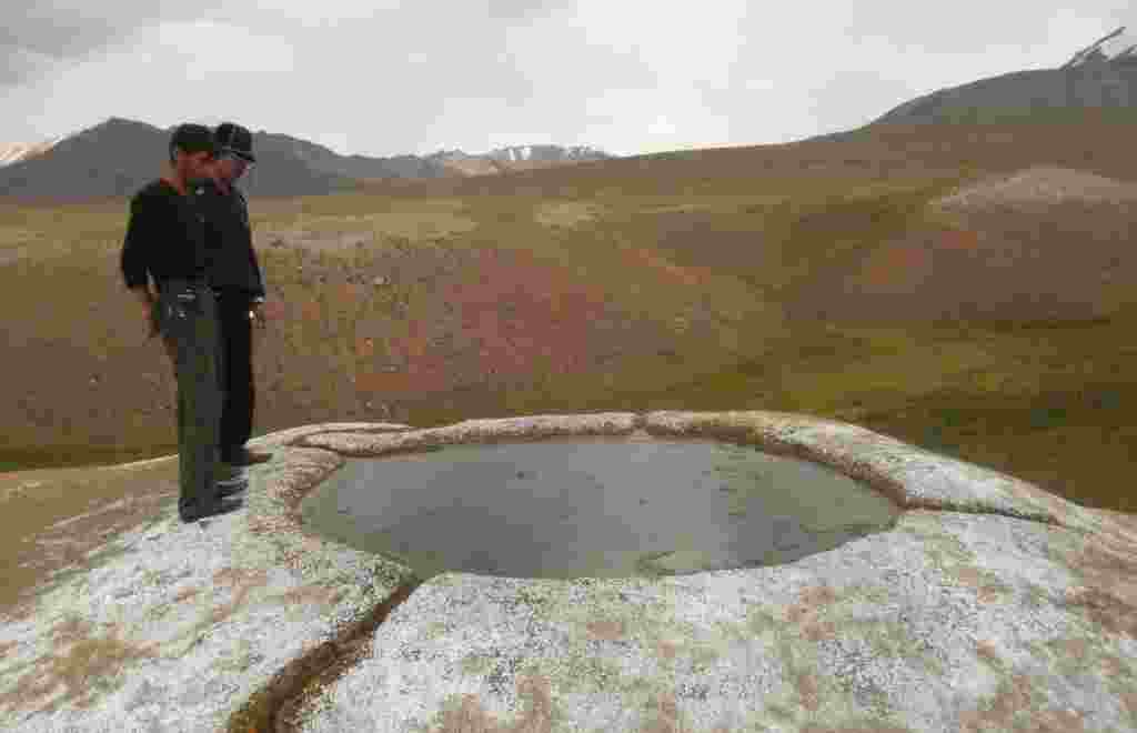 A pool at the Bakpur-Ata shrine. Kyrgyz debate the origins of the holy site. Some say it's named after a relative of the Kyrgyz hero Manas, while others say its name comes from Babur, the founder of the Mogul Empire in the 16th century.