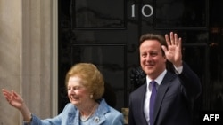 Британи -- Британин премьр-министр лаьттина йолу Тэтчер Маргарет карарчу хенахь Британин премьр-министр волчу Кэмерон Дэвидца, Даунинг стритан неIарехь, 08Ман2010