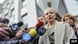 Former Prime Minister Yulia Tymoshenko speaks to the media in front of the prosecutor's office after her interrogation. She and other former members of her cabinet have faced charges they say are politically motivated.