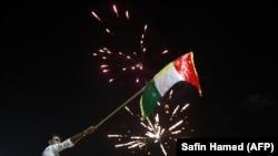 Сторонники независимости Иракского Курдистана празднуют победу на референдуме 25 сентября