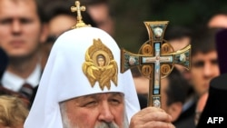 Russian Orthodox Patriarch Kirill blesses believers during a service in Kyiv on July 27.