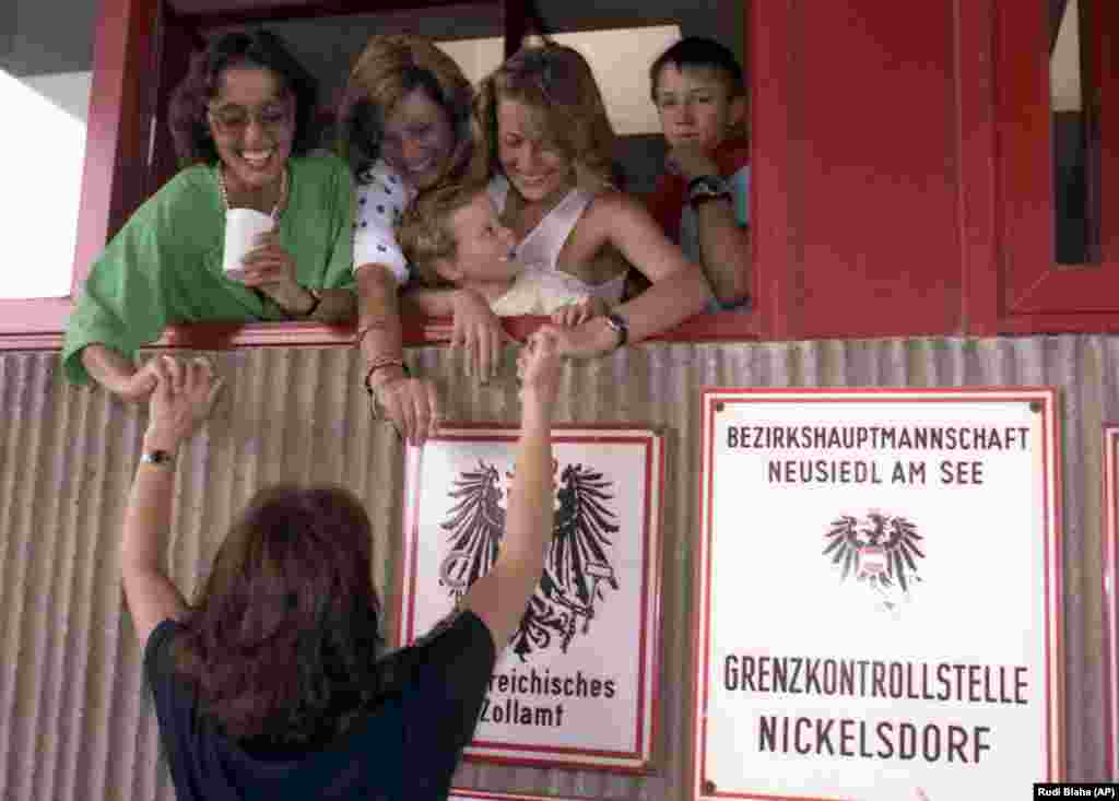 East Germans welcome each other at the customs booth in Nickelsdorf.