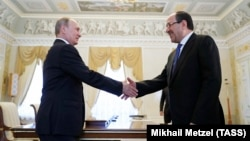 Russian President Vladimir Putin (left) meets with Iraqi Vice President Nuri al-Maliki in St. Petersburg on July 25.
