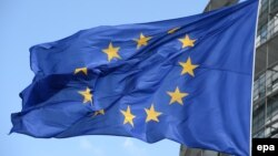 France -- The EU flag flies outside of the European Parliament in Strasbourg, June 30, 2014