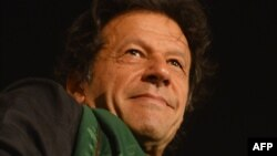 Pakistani opposition politician Imran Khan attends a protest in front of Parliament in Islamabad on August 20, 2014.