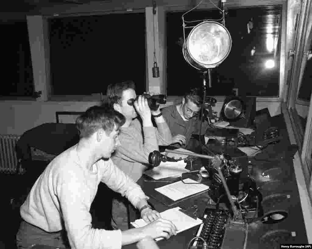 Three U.S. soldiers coordinate the heavy air traffic into Tempelhof on July 1, 1948.
