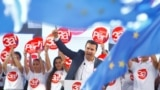 Macedonian Prime Minister Zoran Zaev addresses a march in support of a referendum on changing the country's name and its NATO and EU membership bids in Skopje oon September 16.