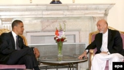 U.S. President-Elect Barack Obama (left) met with Afghan President Hamid Karzai in Kabul during the campaign in July.