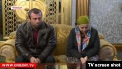 Chechen social worker Ayshat Inayeva (left) and her husband looked very contrite when they had to meet with Ramzan Kadyrov on TV after she had sharply criticized the Caucasus leader.