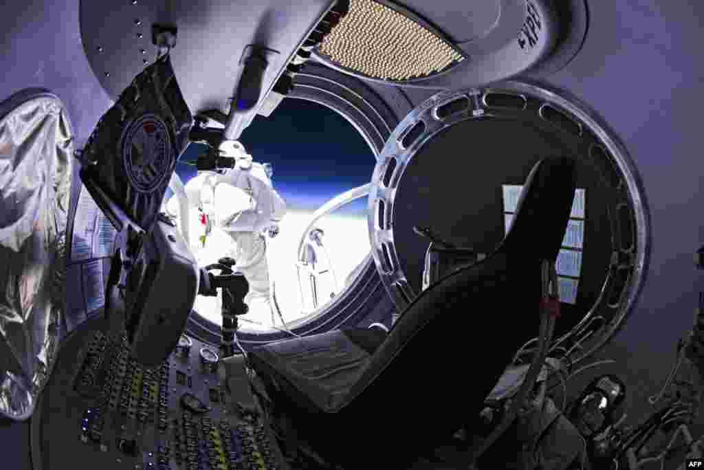 Baumgartner is shown standing on the lip of the capsule just moments before his jump.