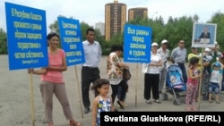 Protesters say local authorities routinely confiscate land from people with dubious justification. They have held similar actions in recent months, such as this one in Astana in June.