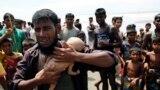 Rohindža drži sina kojem je bilo samo 40 dana kada je preminuo dok su bežali preko granice Mjanmara i Bangladeša