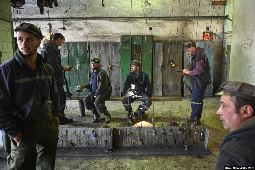 Miners stand in a locker room before starting their shift at the Lonea coal mine.