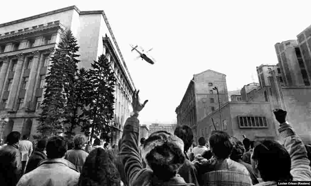 "December 1989: Revolution in Romania. After scores of civilians are killed in a crackdown on antigovernment demonstrators, communist leader Nicolae Ceausescu makes a speech aimed at demonstrating the people's ""devotion"" to him and his equally hated wife. Remarkable live footage of the address broadcasts the moment crowds begin jeering and the omnipotent tyrant shrinks into a confused old man. As people flood the streets the Ceausescus flee in a helicopter. They are soon caught and executed by firing squad."