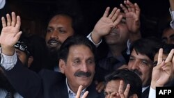 Iftikhar Muhammad Chaudhry (left) waves to supporters at his residence in Islamabad after his reinstatement was announced