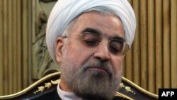 Experts say Iranian President Hassan Rohani may well be constrained by hard-line elements.