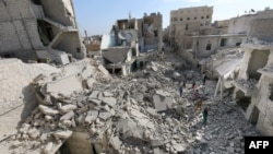 Destruction in Aleppo following barrel bombing by Syrian government forces (file photo)