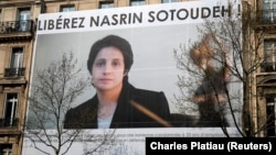 A banner with a giant portrait of jailed Iranian lawyer Nasrin Sotoudeh is seen on the headquarters of the French National Bar Council, which demanded her release, in Paris in March.