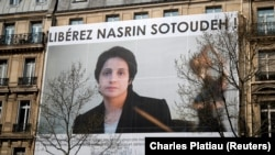 FRANCE -- A banner with a giant portrait of jailed Iranian lawyer Nasrin Sotoudeh is seen on the headquarters of the French National Bar Council, demanding her release, in Paris, March 28, 2019