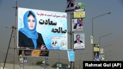 Campaign posters for Afghanistan's upcoming parliamentary elections are displayed on a Kabul street on September 28.