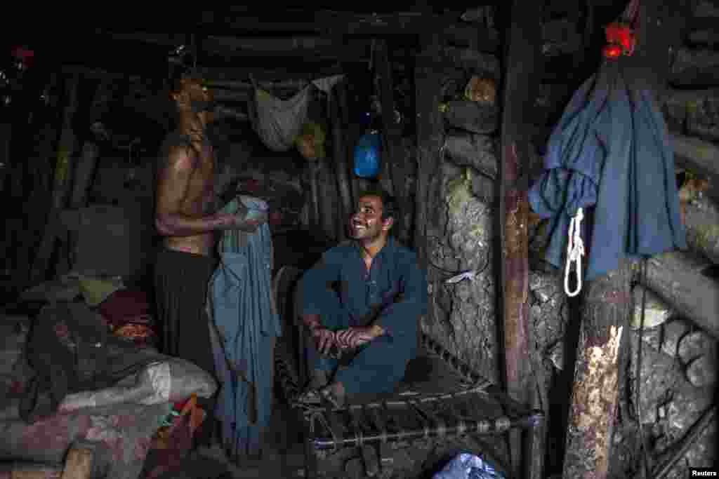 Miners rest in an underground room at the end of a workday.