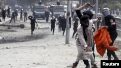 Եգիպտոս - Ոստիկանության եւ ցուցարարների միջեւ բախումները մայրաքաղաք Կահիրեում, 28-ը հունվարի, 2013թ.