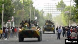 Armored vehicles patrol in Osh amid the rioting on June 11.