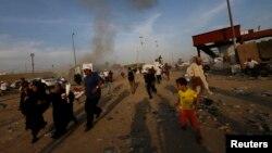 انفجارها در يک گردهمايی انتخاباتی يک گروه شيعه در بغداد