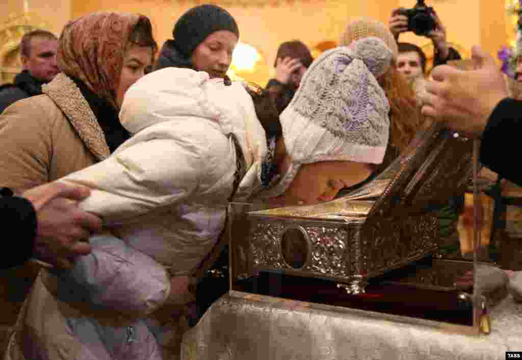 A Russian Orthodox believer kisses the shrine with the Gifts of the Magi relic displayed at the Resurrection Novodevichy Convent in St. Petersburg on January 14. (ITAR-TASS/Ruslan Shamukov)