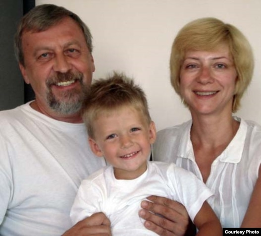 Iryna Khalip (right) with jailed husband Andrey Sannikau and their son Daniil.