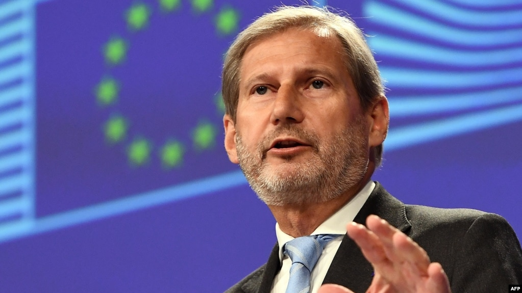 EU Enlargement Negotiations Commissioner Johannes Hahn speaks at a news conference in Brussels on June 12.