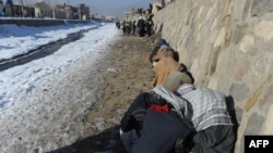 Drug addicts use heroin and other narcotics near the Kabul River in the capital.