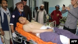 An injured man is treated at a hospital following a deadly attack in Kabul on September 5.