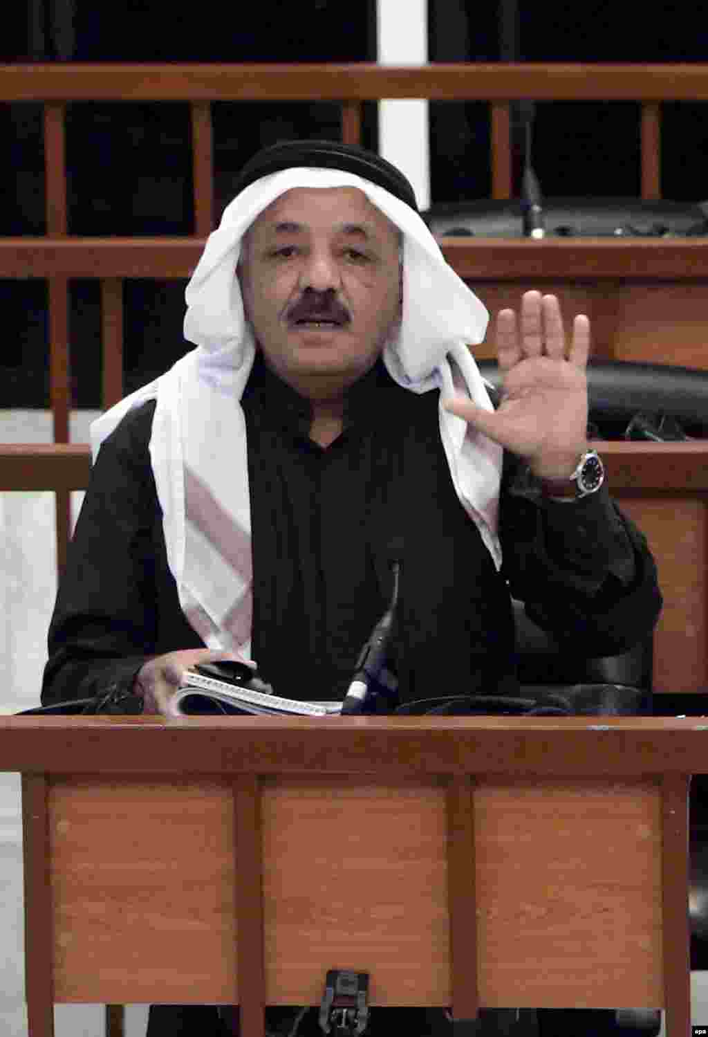 Taha Yassin Ramadan addresses the court as his verdict is being read (epa) - Taha Yassin Ramadan was a vice president of Iraq under Hussein. He was sentenced to life in prison.
